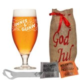 Christmas giftbag with a cap opener, candy and a Innis & Gunn beer glass half pint
